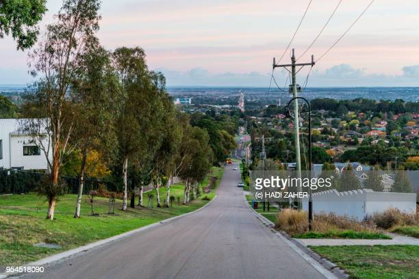 a sloped street in suburban melbourne | australia - street stock pictures, royalty-free photos & images