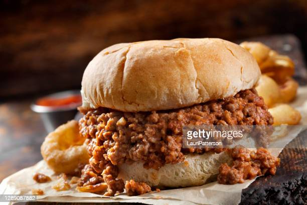 sloppy joe sandwich with onion rings - sloppy joe, jr stock pictures, royalty-free photos & images