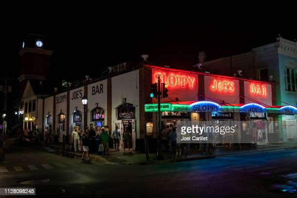 sloppy joe's bar at night in key west - key west stock photos and pictures