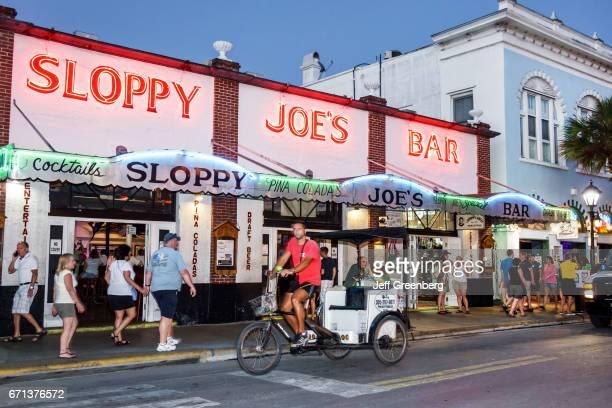 Sloppy Joe's Bar entrance at night.