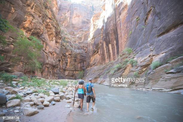 slot canyon adventuring - zion national park stock pictures, royalty-free photos & images
