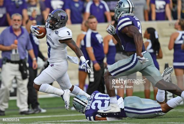 Slot receiver Brandon Cox of the Central Arkansas Bears rushes past strong safety Denzel Goolsby of the Kansas State Wildcats for a touchdown during...