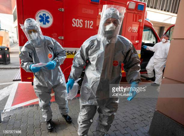 Slovak emergency personnel wearing protective suits enter the University hospital of Merciful Brothers where they are to a samples from 3 patients to...