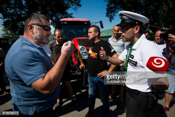 A Slovak farmer argues with a policeman on June 20 2018 in Bratislava downtown during a protest ride against irregularities in EU farm subsidy...