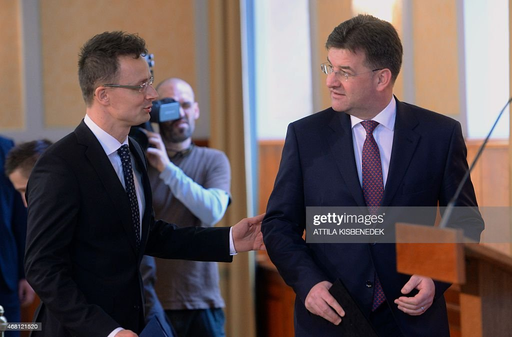 Slovak Foreign Minister Miroslav Lajcak (R) arrives into the conference hall of the ministry building with Hungarian Minister of External Economy and Foreign Affairs Peter Szijjarto (L) in Budapest on March 30, 2015 prior to their joint press conference. Miroslav Lajcak arrived today for his one-day visit to Budapest.