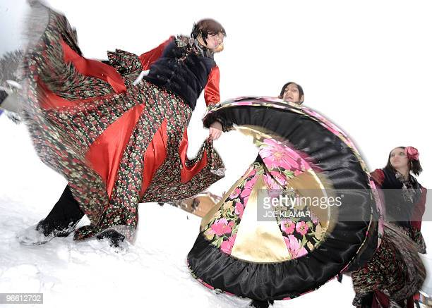 Slovak girls dance dressed in carnival outfits near the sleddog sprint European championship course at central Slovakia's resort of Donovaly on...