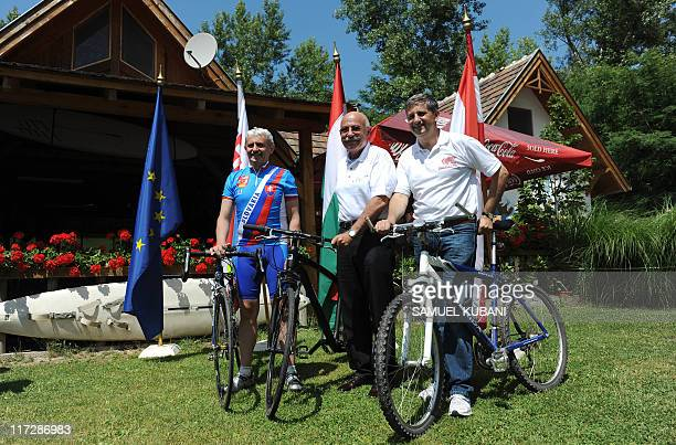 Slovak Minister of Foreign Affairs Mikulas Dzurinda and Austrian Minister of Foreign Affairs Michael Spindelegger pose with Hungarian Minister of...