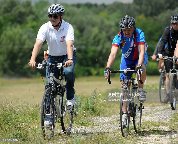 Slovak Minister of Foreign Affairs Mikulas Dzurinda and Austrian Minister of Foreign Affairs Michael Spindelegger ride bicycles on June 25 2011...
