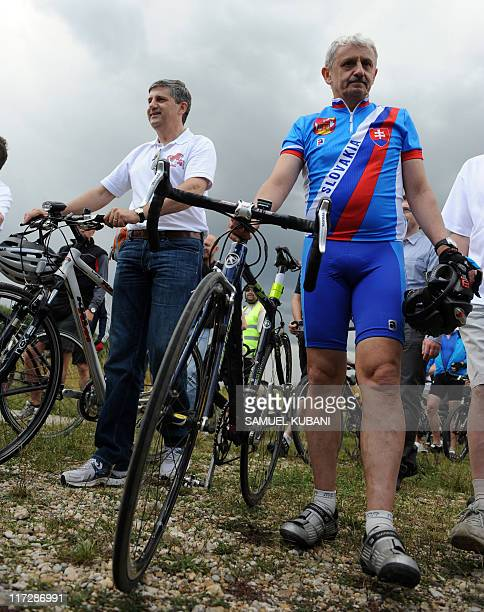 Slovak Minister of Foreign Affairs Mikulas Dzurinda and Austrian Minister of Foreign Affairs Michael Spindelegger hold bicycles on June 252011 during...