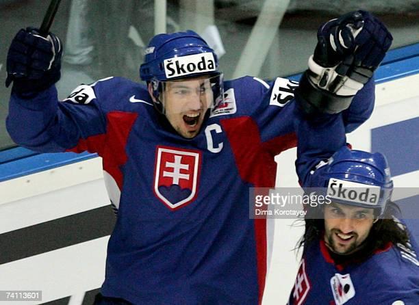 Slovak Miroslav Satan and Marek Uram celebrates after scoring against team Sweden during the IIHF World Ice Hockey Championship quarter final match...