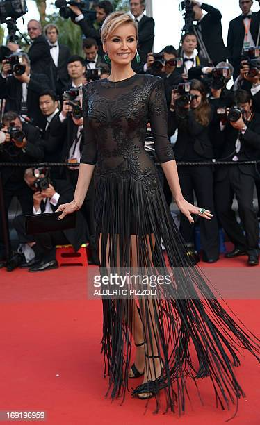 Slovak model Adriana Karembeu poses on May 21 2013 as she arrives for the screening of the film Behind the Candelabra presented in Competition at the...