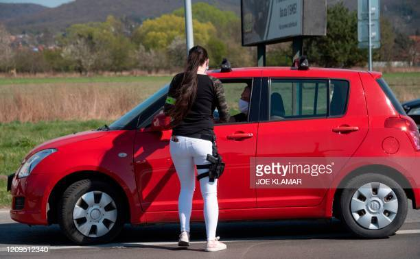 Slovak police officer stop a cars to check the purpose of their travel between Bratislava and Malacky counties near the village of Zahorska Bystrica,...