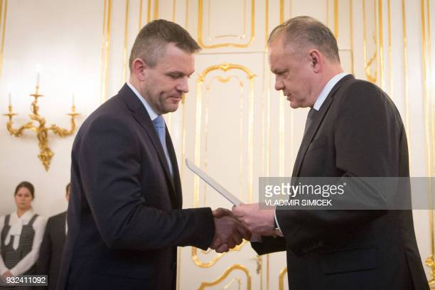 Slovak President Andrej Kiska hands over the certificate of appointment to Peter Pellegrini to form a new government after the resignation of the...