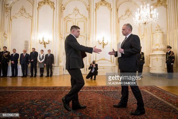 TOPSHOT Slovak President Andrej Kiska receives a resignation letter from Slovak Prime Minister Robert Fico in Bratislava on March 15 2018 Slovakia's...