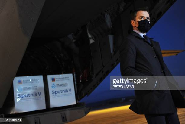 Slovak Prime Minister Igor Matovic wears a face mask as he gives a press statement at the International Airport in Kosice, Slovakia, on March 1 after...