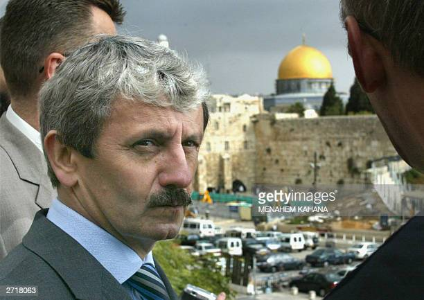 Slovak Prime Minister Mikulas Dzurinda is seen during a tour of Jerusalem's Old City 11 November 2003 with the Western Wall and the Dome of the Rock...