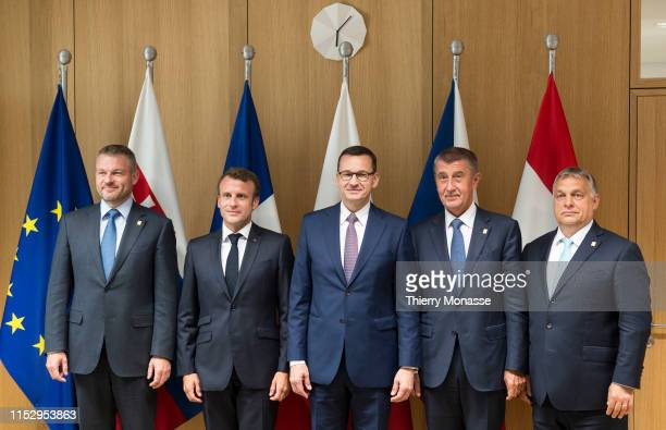 Slovak Prime Minister Peter Pellegrini French President Emmanuel Macron Polish Prime Minister Mateusz Morawiecki Czech Prime Minister Andrej Babis...