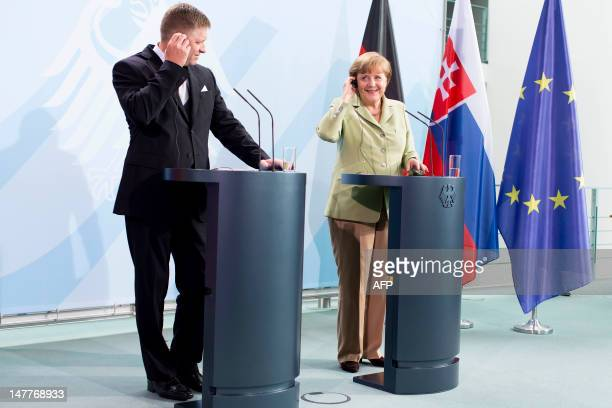 Slovak Prime Minister Robert Fico and German Chancellor Angela Merkel attend a joint press conference at the Chancellory in Berlin on July 03, 2012....