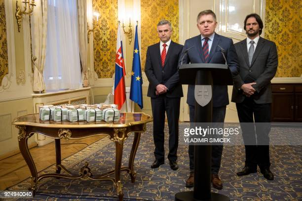 Slovak Prime Minister Robert Fico is flanked by Slovak Police President Tibor Gaspar and Slovak Interior Minister Robert Kalinak as they stand next...