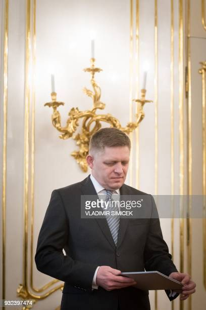 Slovak Prime Minister Robert Fico wait for his audience to hand in his letter of resignation to Slovak President Andrej Kiska in Bratislava on March...