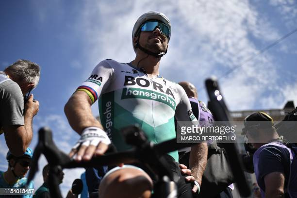 Slovak rider Peter Sagan waits in the departing area during the signing in ceremony at the Place Royale - Koningsplein Square before the start of the...