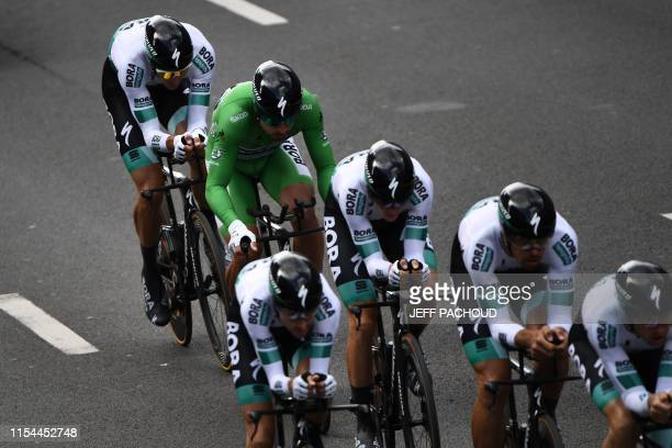 Slovak rider Peter Sagan wearing best sprinter's green jersey and teammates of Germany's Bora-Hansgrohe cycling team compete in the second stage of...