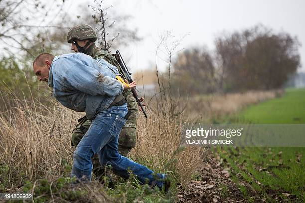 A Slovak soldier detains a man playing the role of an illegal migrant during a joint exercise of Slovak police and Slovak Army focused on protecting...