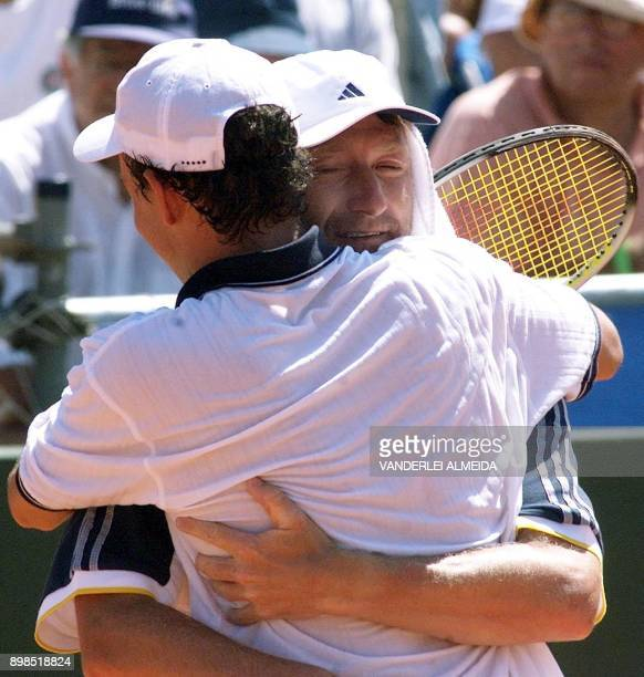 Slovak tennis player Dominik Hrbaty celebrates his victory over Brazilian Gustavo Kuerten with his coach Miroslav Mercir during the quarter final...