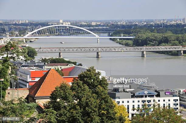 Slovakia Bratislava Bratislava Apollo Bridge in the background and Stary Most in the foreground over river Danube