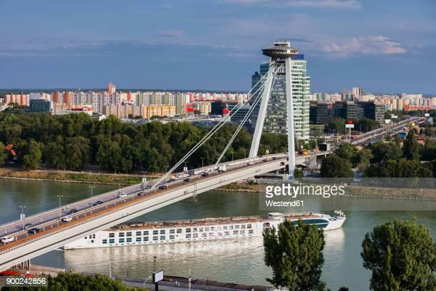 Slovakia, Bratislava, cityscape, Most SNP bridge and passenger boat on Danube River