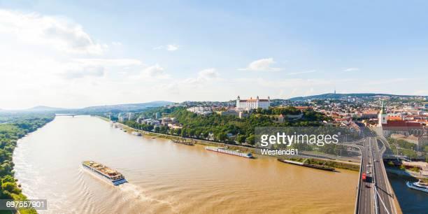Slovakia, Bratislava, cityscape with river cruise ship on the Danube