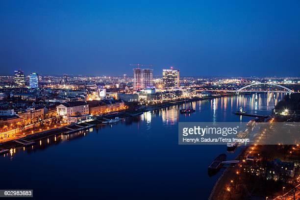 Slovakia, Bratislava, Illuminated cityscape and river at night
