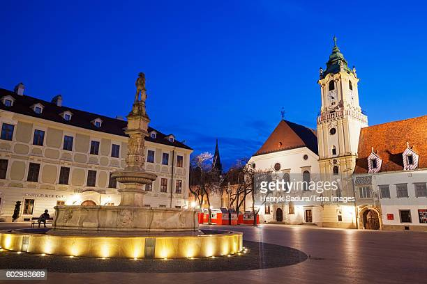 Slovakia, Bratislava, Illuminated town square at dusk