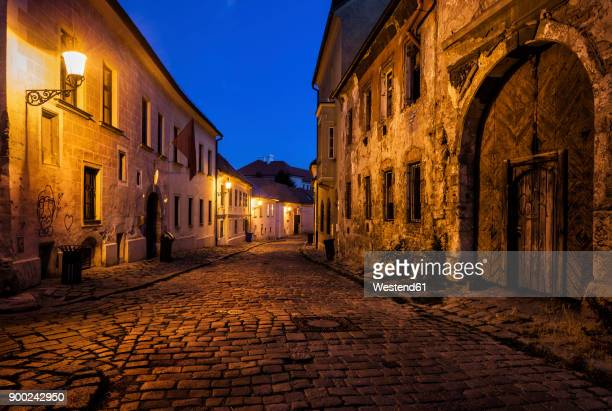 slovakia, bratislava, old town at night, cobbled street, old building with aged facade - slovakia stock pictures, royalty-free photos & images
