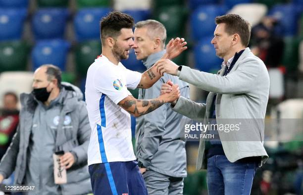 Slovakia Coach Stefan Tarkovic congratulates Slovakia's striker Michal Duris as he celebrates scoring his team's second goal in extra time during the...
