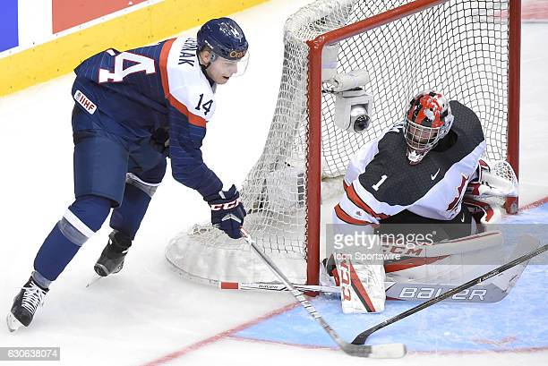 Slovakia defenceman Erik Cernak is stopped in this scoring attempt on Canada goalie Connor Ingram during the Slovakia versus Canada game on December...