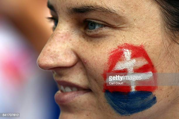 Slovakia fans sport temporary face tattoos as they looks on as supporters gather ahead of today's England v Slovakia UEFA Euros 2016 Group B match on...