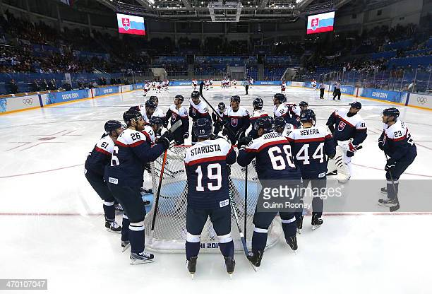 Slovakia huddle around the net before the Men's Qualification Playoff Game against Czech Republic on day 11 of the Sochi 2014 Winter Olympics at...