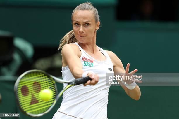 Slovakia Magdalena Rybarikova returns against Spain's Garbine Muguruza during their women's singles semifinal match on the tenth day of the 2017...