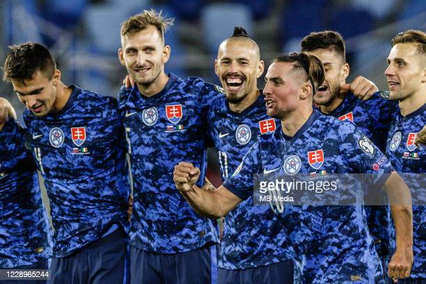 Slovakia players celebrate victory after a penalty shootout during the UEFA EURO 2020 Play-Off Semi-Final match between Slovakia and Republic of...