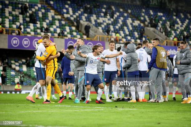 Slovakia players celebrate winning the game after extra time during the UEFA Nations League path B play-off final football match between Northern...