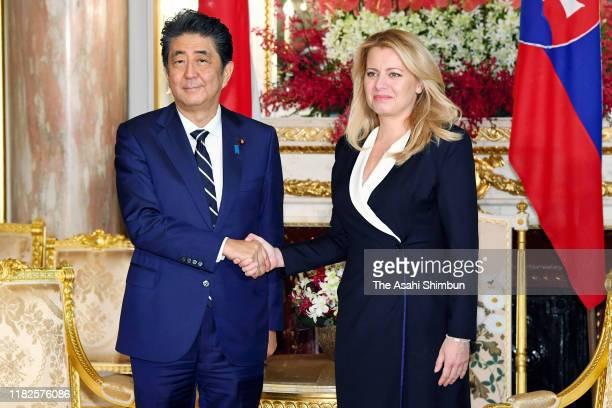 Slovakia President Zuzana Caputova shakes hands with Japanese Prime Minister Shinzo Abe prior to their meeting at the Akasaka State Guest House on...