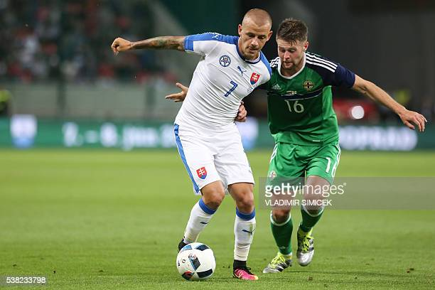 Slovakia's Vladimir Weiss and Northern Ireland's Oliver Norwood ' vie for the ball during the friendly football match between Slovakia and Northern...