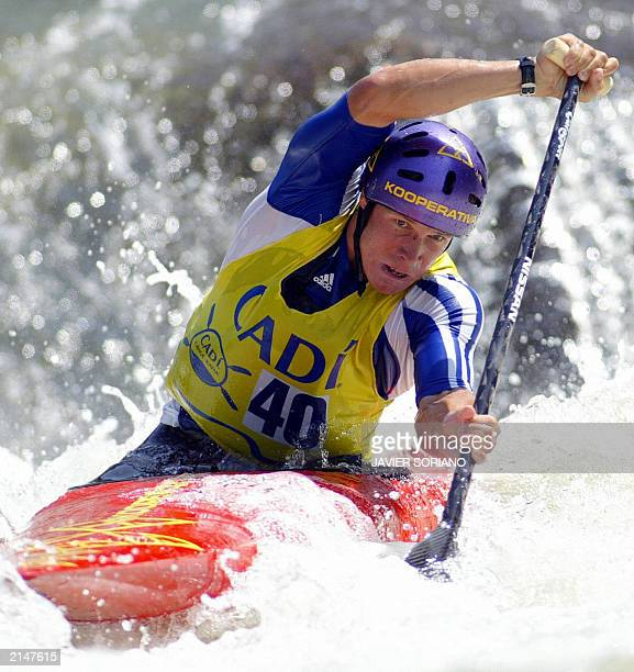Slovakian canoeist Michal Martikan powers his way through a wave 06 July 2003 during the men's C1 canoe slalom final run at the Slalom World Cup in...