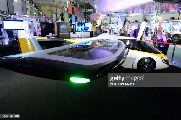 Slovakian company AeroMobil's flying car is displayed at Le Bourget on June 21 during the International Paris Air Show / AFP PHOTO / ERIC PIERMONT