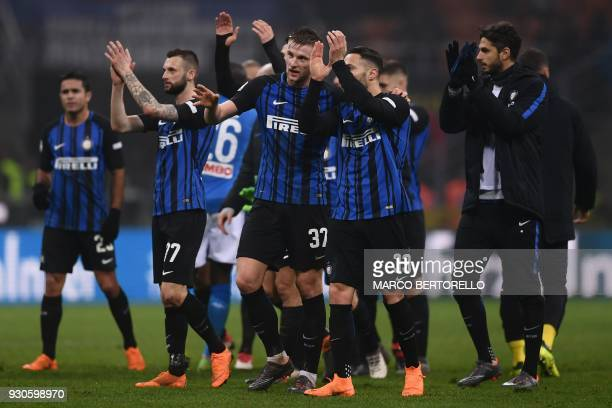 Slovakian defender Milan Skriniar and Italian defender Danilo D'Ambrosio acknowledge the public after the Italian Serie A football match Inter Milan...