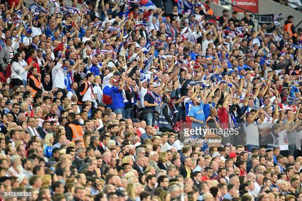 Slovakian fans stand cheering on their team as England fans watch from their seats during the World Cup 2018 qualification football match between...
