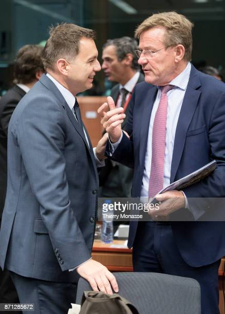Slovakian Finance Minister Peter Kazimir and the Belgian Finance Minister Johan Van Overtveldt are looking at a folder during an Eurozone Ministers...