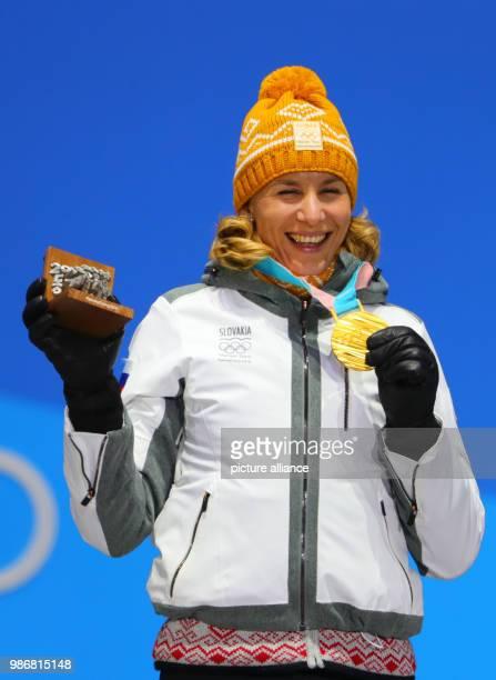 Slovakian gold medallist Anastasiya Kuzmina celebrates on the podium during the medal ceremony of the women's 125km biathlon event on day nine of the...