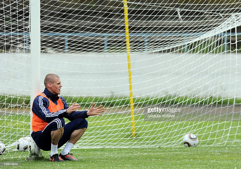 Slovakian national football player Martin Skrtel sits on a ball during a training session on May 20, 2010, at their training camp in Piestany, prior to the FIFA World cup 2010 held in South Africa.